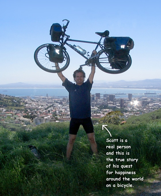 A 4-color photograph of Scott holding his bicycle over his head on top of Table Mountain in Cape Town, South Africa. Text: Scott is a real person, and this is the true story of his quest for happiness around the world on a bicycle.