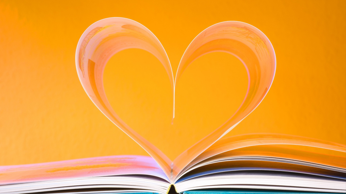 Book with pages bent into the shape of a heart.