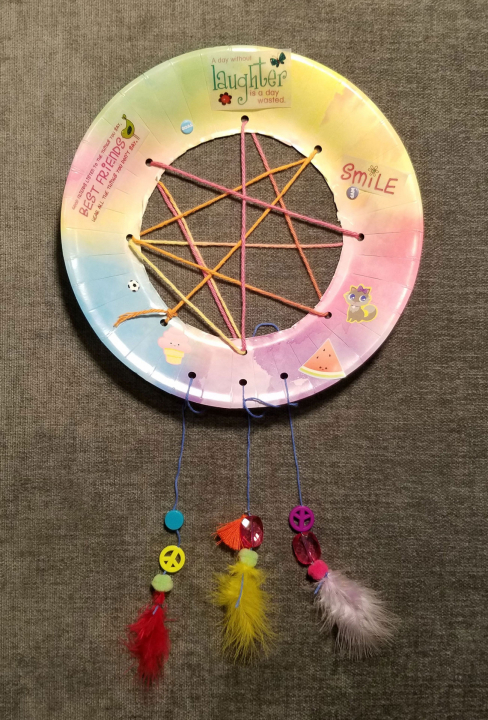 A child's dream catcher that catches the good dreams, in this case: friends, laughter and smiles.