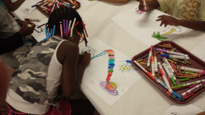A girl illustrates building a rainbow bridge