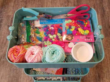 Scissors, hole punch, glue, colorful yarn, feathers, beads, charms, stickers, pom poms, markers, crayons..