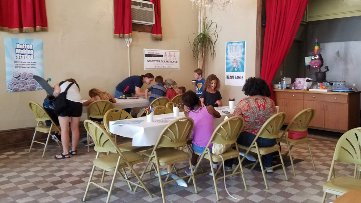 Dream Workshop and Dream Party. Pictured are parents and kids making buttons and doing brain games.