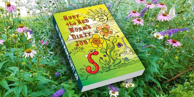 Ruby the Red Worms Dirty Job book cover in front of a beautiful garden.