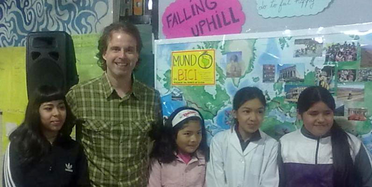 Scott presenting his story of bicycling around the world at Fuerte Apache school in Argentina.