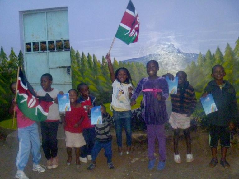 Kenyan school children jump for joy when they got their Falling Uphill books.